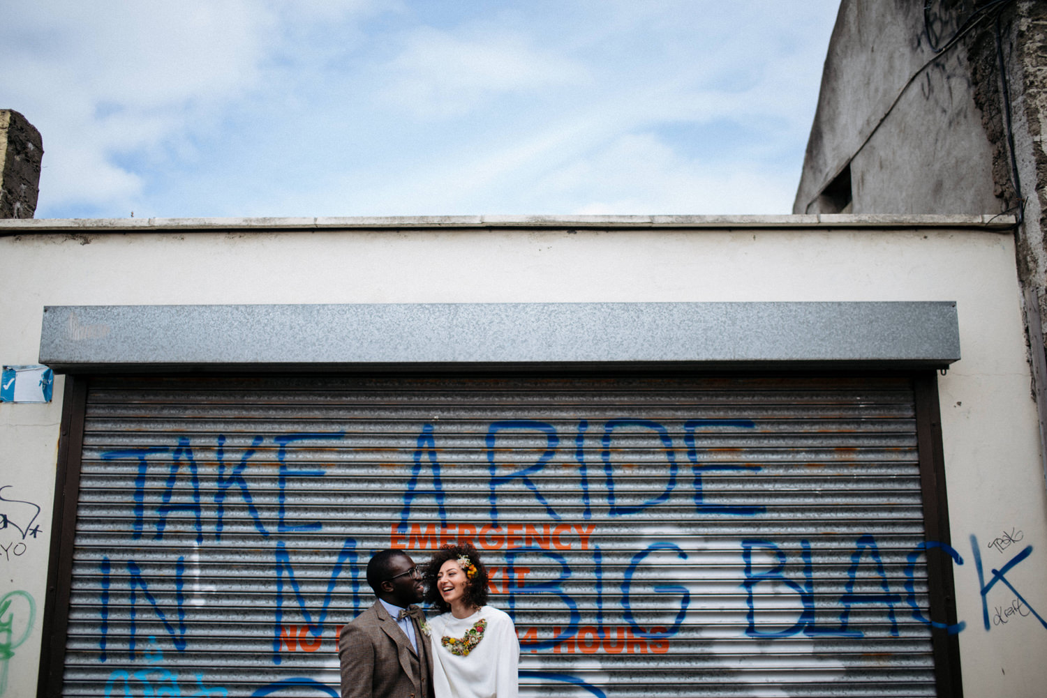 funny dublin city wedding portraits interracial couple