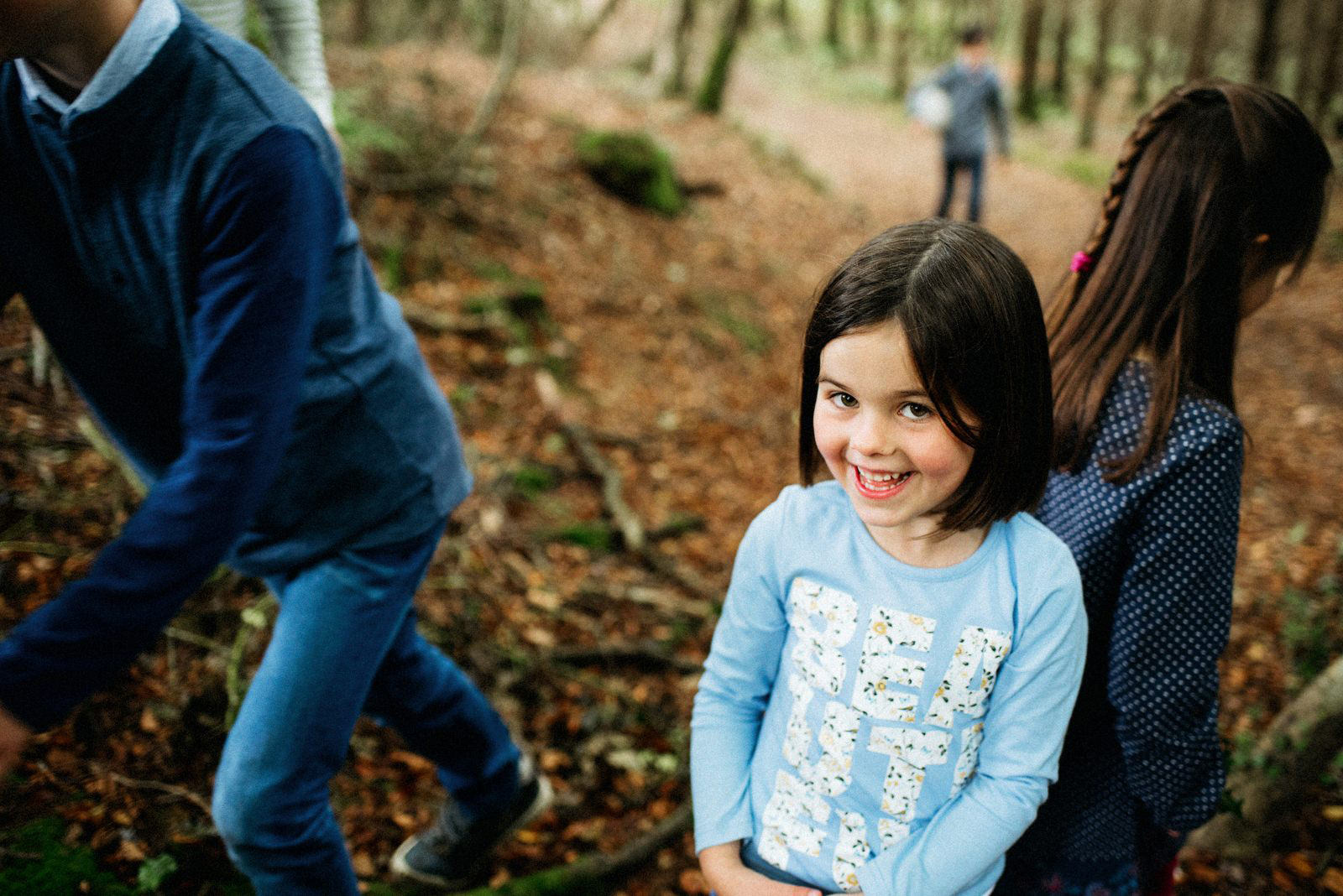 family walking in the woods family shoot