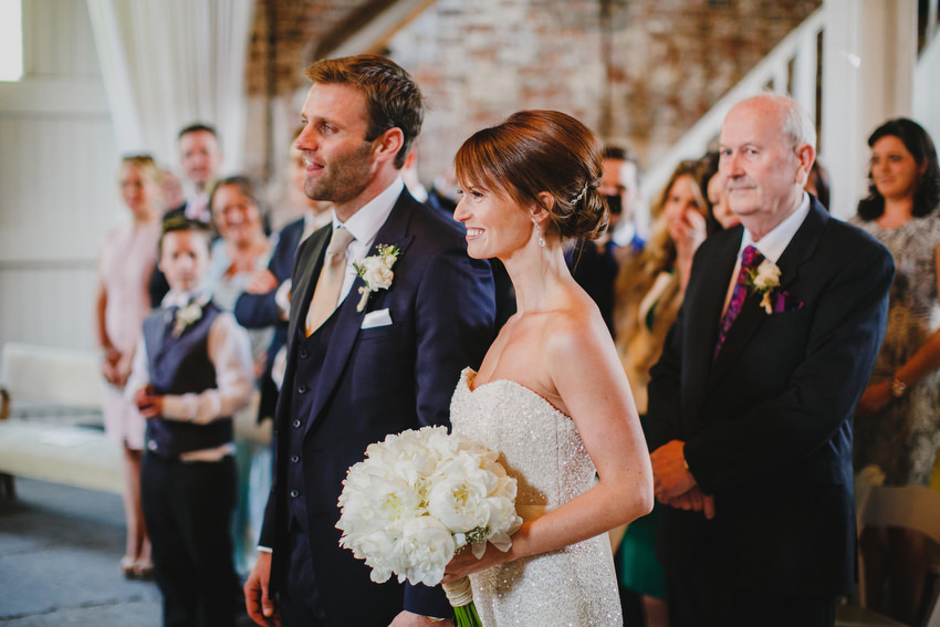 Happy couple at end of the aisle