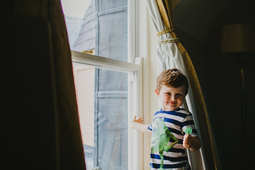 kid at window with green lollipop