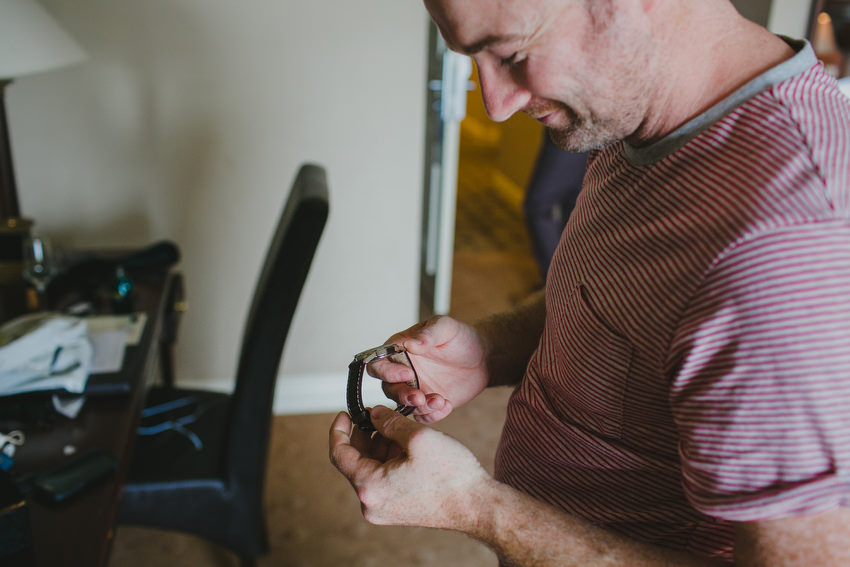 groom receives a present of a watch on morning of his wedding