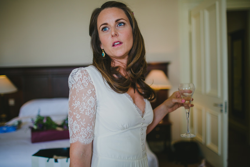 relaxed bride with glass of champagne