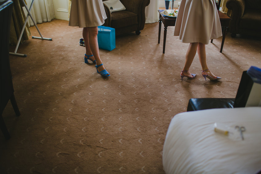 bridesmaids feet with blue shoes and purple shoes