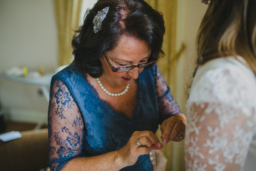 mother of the bride holding needle
