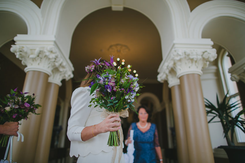 bride holding flowers at marine hotel in dun laoghaire