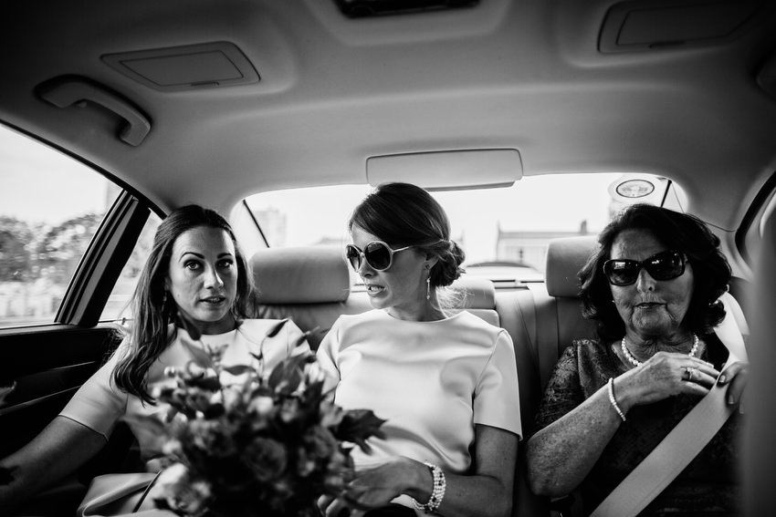 bridesmaids in car with sunglasses
