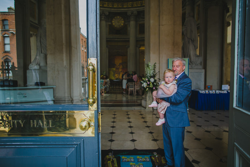 father of the groom and child inside dublin city hall
