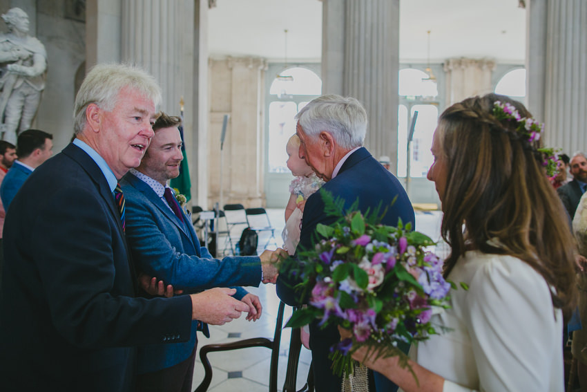 bride and father come down the aisle dublin city hall