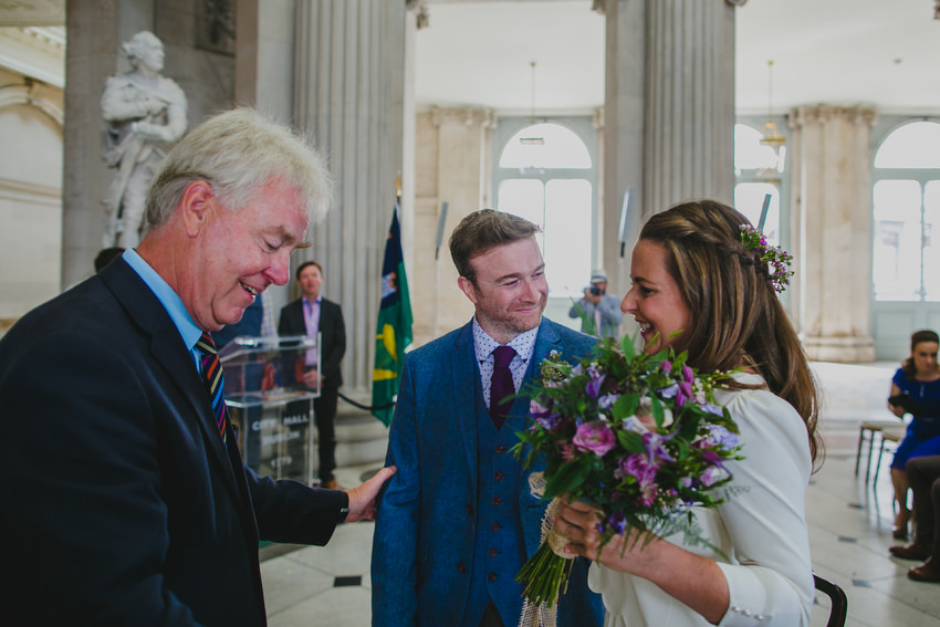 bride and groom and brian whiteside at dublin city hall
