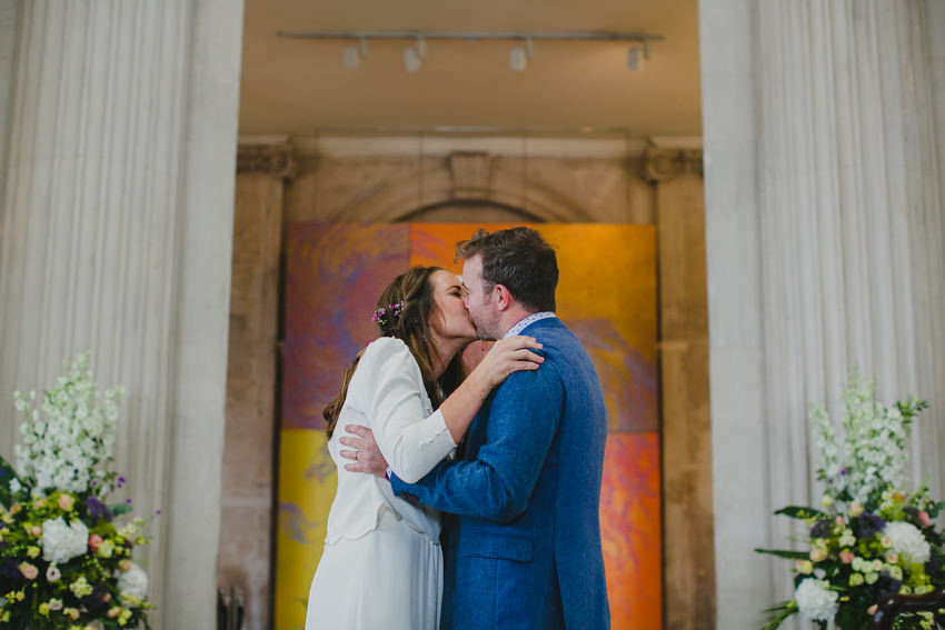 bride and groom taking vows and first kiss at dublin city hall