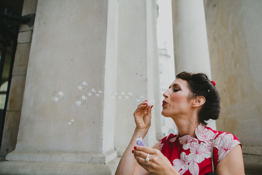 guests blow bubbles after wedding at dublin city hall
