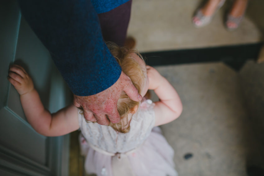 fathers hand on daughters head
