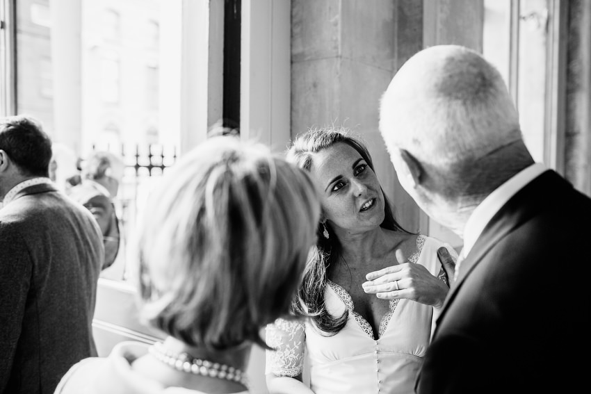 bride greets guests after wedding at dublin city hall