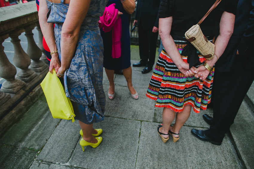 colourful dresses of guests leaving wedding at dublin city hall
