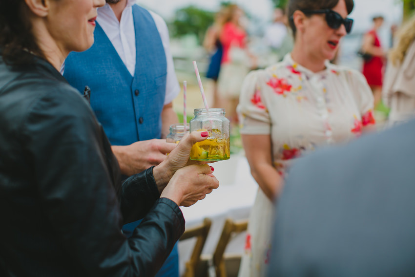 guests enjoying drinks in jars with straws at olivetos restaurant for wedding