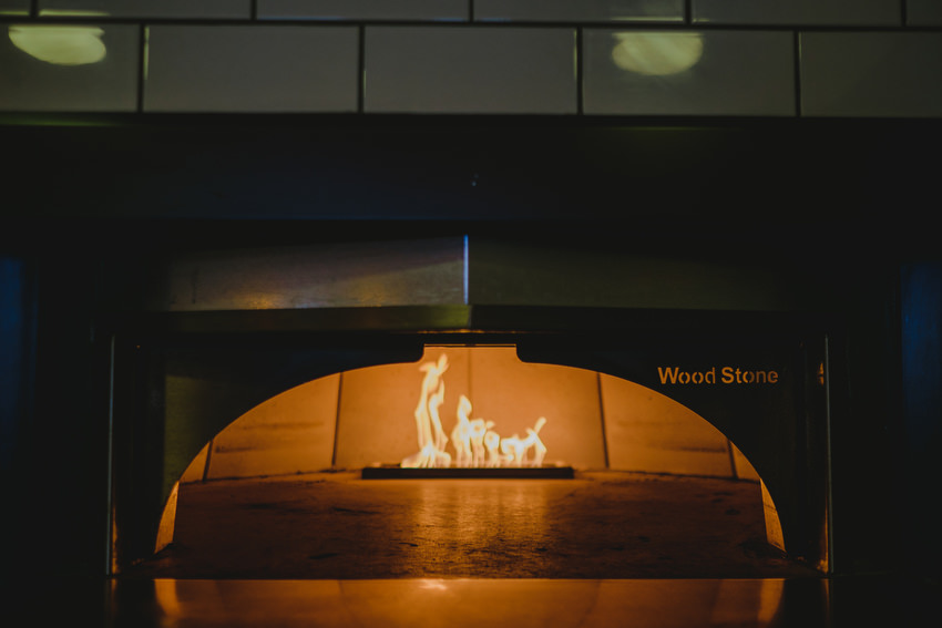 wood stone pizza oven in the kitchen of oliveto restaurant