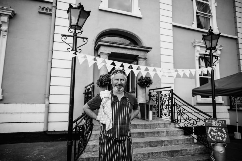 owner with bunting at oliveto restaurant