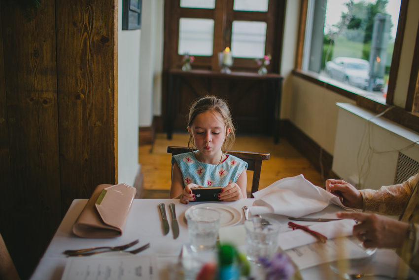 young girl plays with phone at oliveto