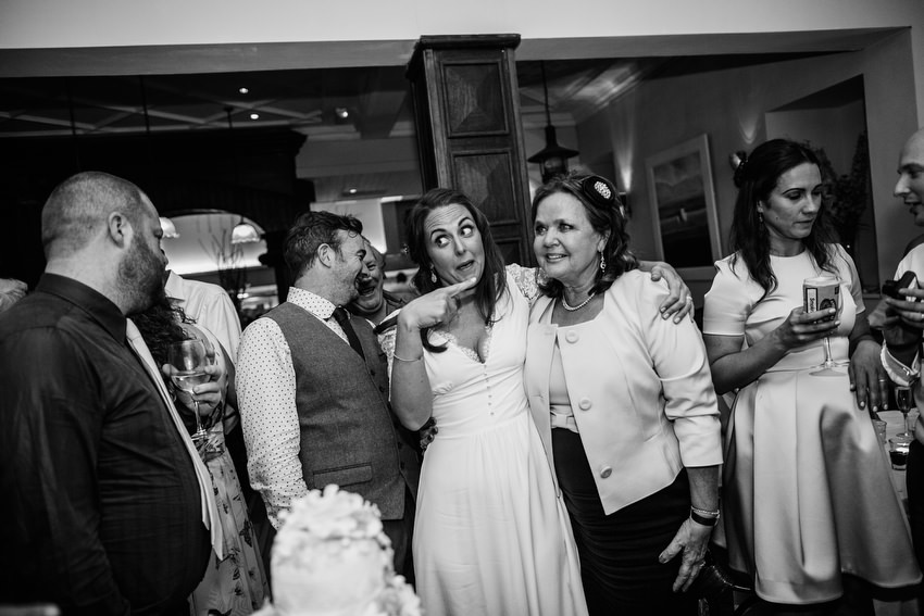 bride and groom cut the cake at the wedding in oliveto