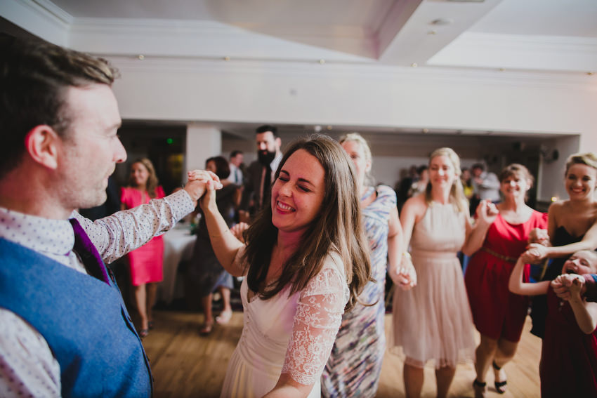 crowd join first dance with bride and groom at oliveto restaurant