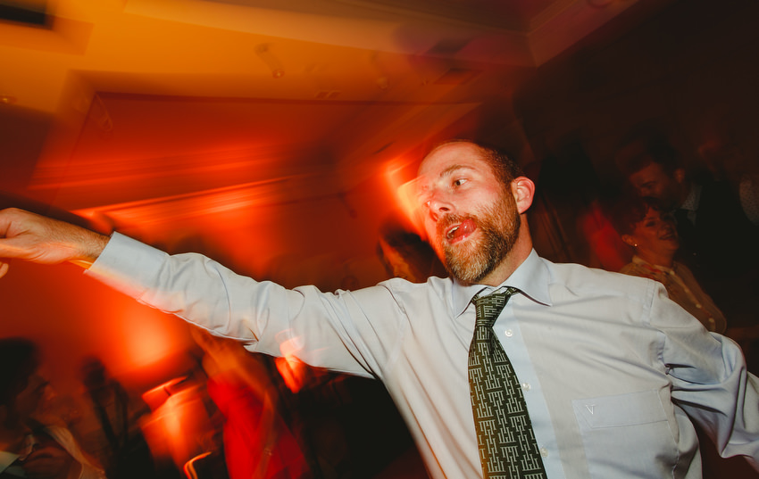 wedding  guests dancing with light trails at wedding in oliveto dun laoghaire