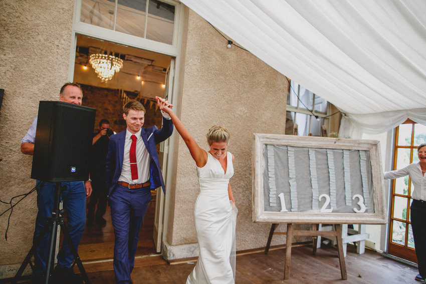 bride and groom make entrance at coughjordan house
