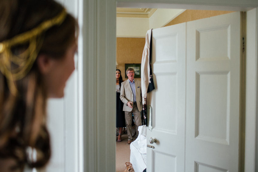 father waits to see his daughter the bride