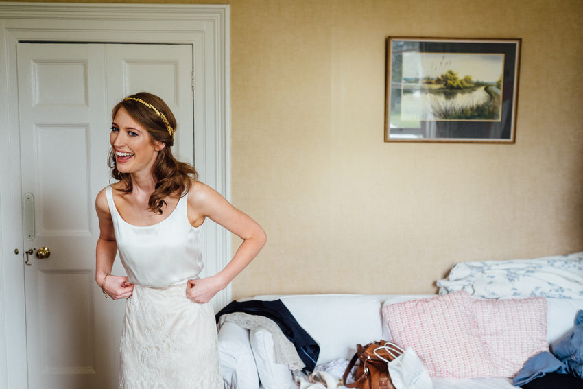 very happy and gorgeous bride at ballyvolane house