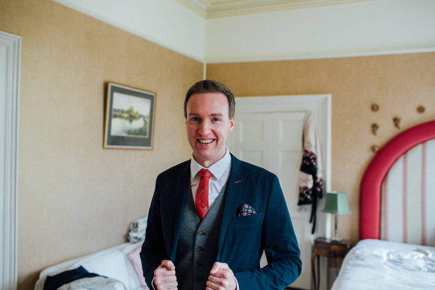 happy and handsome groom