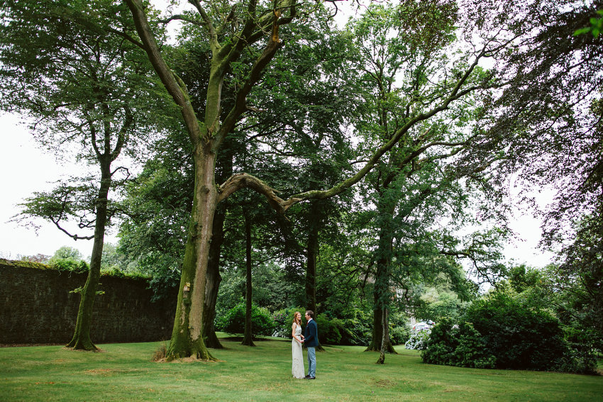 bride and groom in the woods at ballyvolane