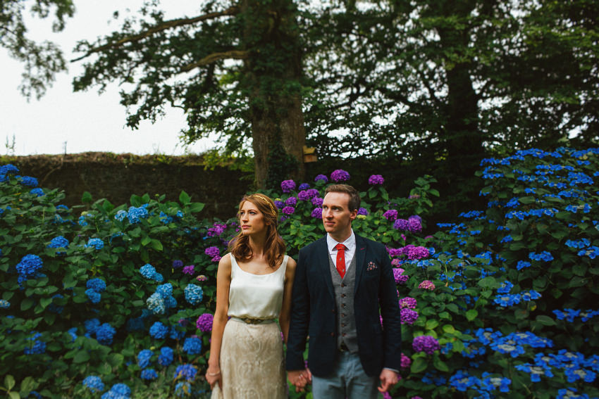 bride and groom with hydrangeas at ballyvolane