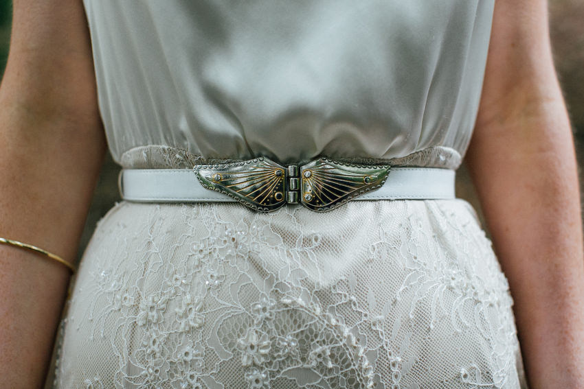 brides wedding dress silver and gold belt with wings