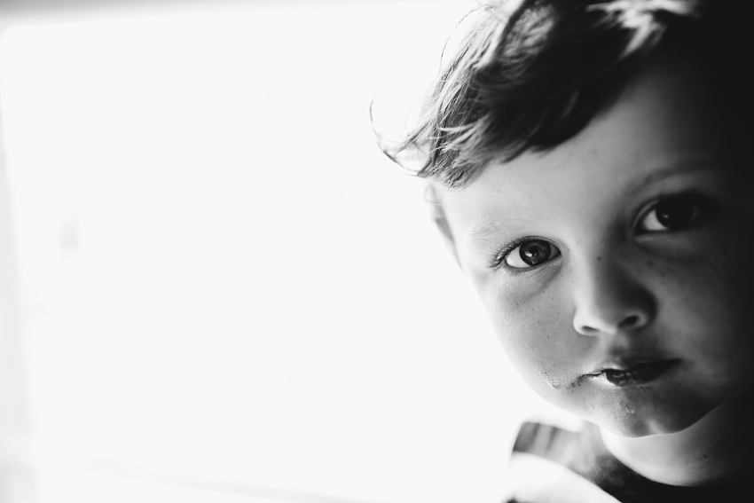 portrait of small boy in black and white