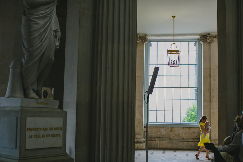 yellow dress lady with baby at dublin city hall